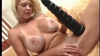 Busty golden-haired milf riding a monster brutal vibrator