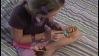 Nubile legal age teenager kitty playing with her little dolls