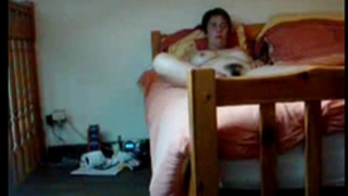Hidden web camera catches my curly mama fingering on daybed